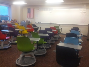 Room with colored, movable desks