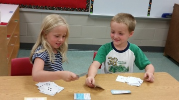 Two of my Kindergartners playing 'Top It' before heading to lunch.