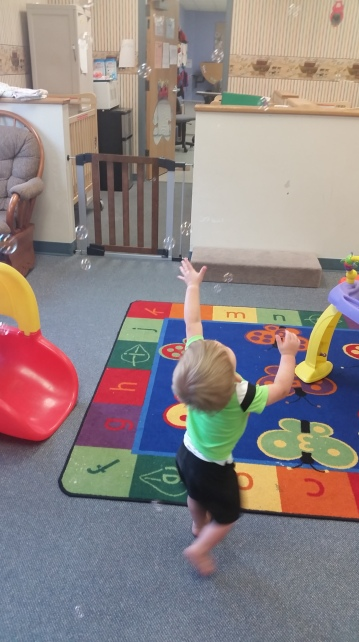 Daycare babies playing with bubbles