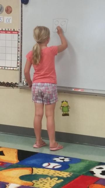 Kindergartners working on math