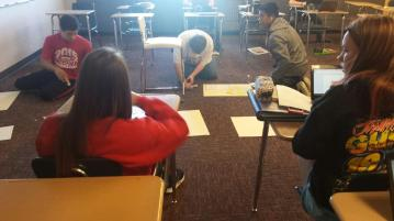 Getting images for their poems; gluing poems to the poster board.
