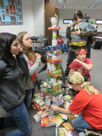 Look how big it is! Creating the Eiffel Tower out of canned/boxed food.