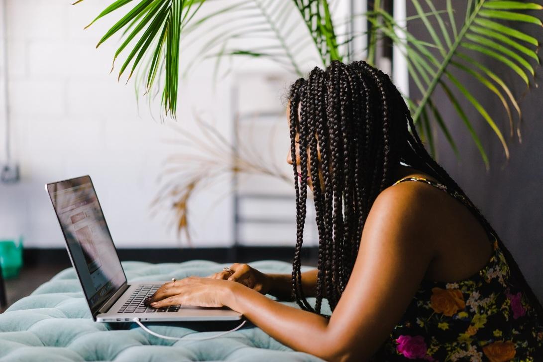 woman typing on computer, teacher productivity